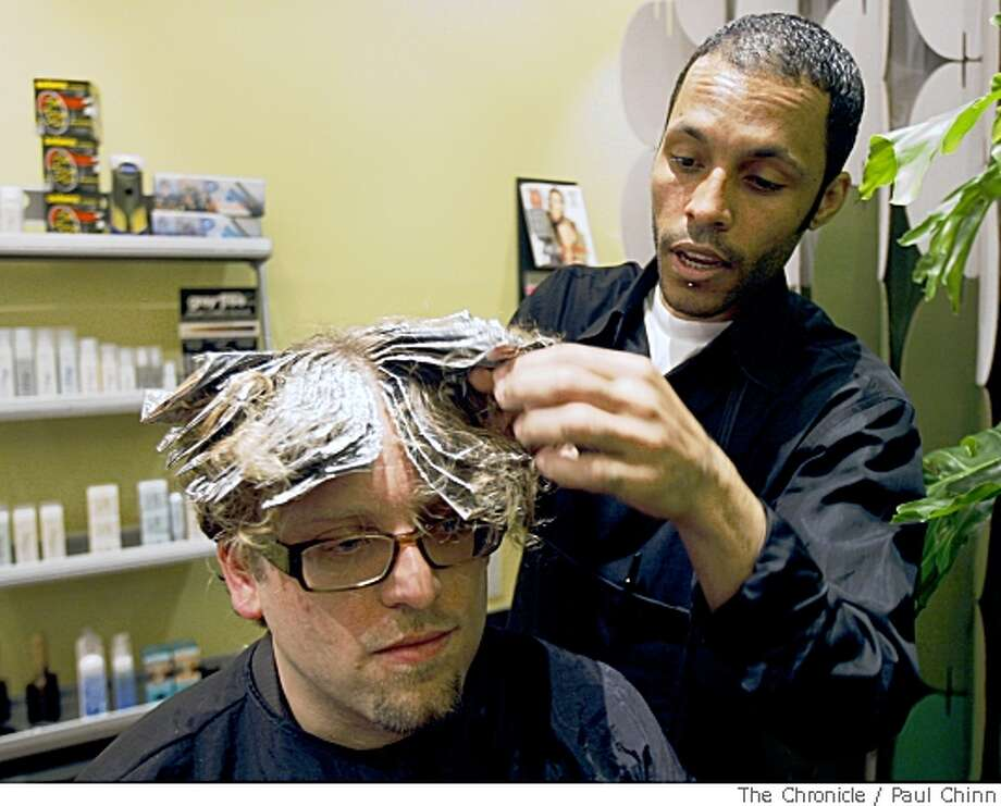 Robert James, right, adds color highlights to William Hudson at James' hair color and highlighting salon in San Francisco, Calif., on Friday, April 18, 2008. Photo by Paul Chinn / San Francisco Chronicle Photo: Paul Chinn, SFC