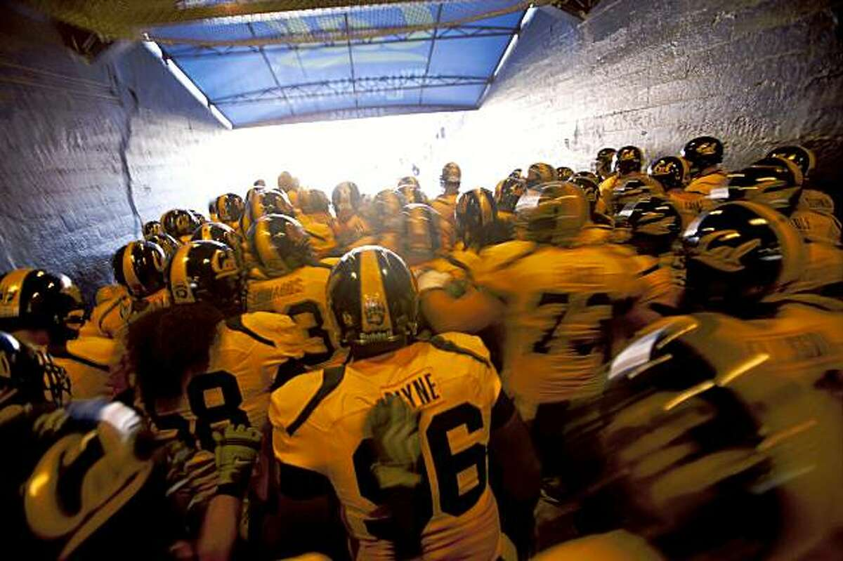 Members of the California Golden Bears runs into Memorial Stadium prior to a game against the visiting USC Trojans in Berkeley, Calif. on Saturday, Oct. 3, 2009.
