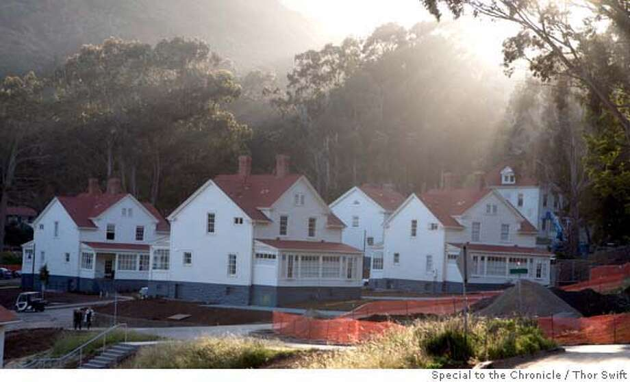Various historic buildings are photographed at Cavallo Point, a new 142-room lodge at Fort Baker at the north end of the Golden Gate Bridge, Saturday, May 3, 2008. These buildings are hotel rooms.  Thor Swift For The San Francisco Chronicle  Ran on: 05-25-2008  Far left: Historic buildings at Cavallo Point, a new 142-room lodge at Fort Baker; clockwise from left, Mike Freed and Peter Heinemann on one of the Cavallo Point porches; Murray Circle Restaurant; two views inside a historic room. Photo: Thor Swift