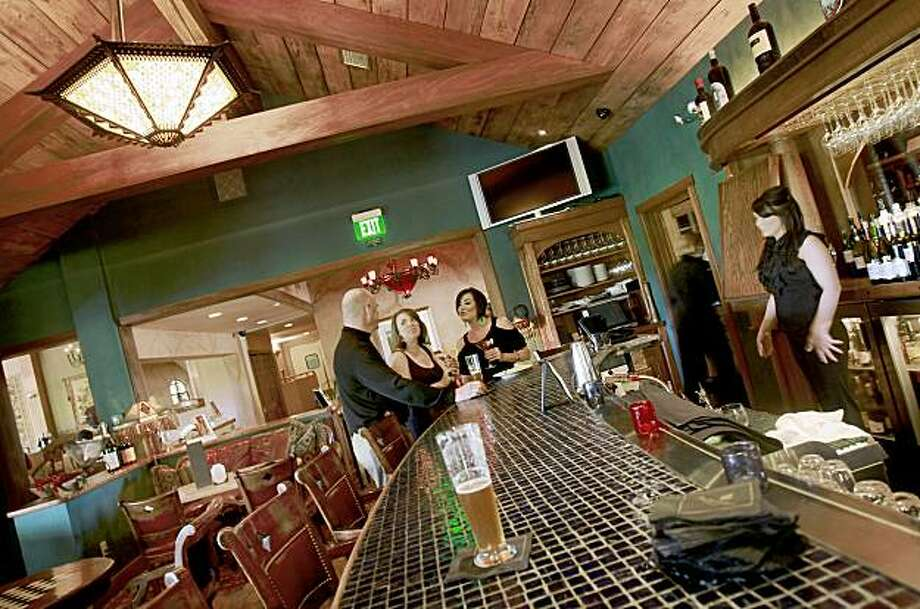 Dark wooden beams and low light contribute to the richness of the lounge area. The Front Room Bar and Lounge at John Ash Restaurant in the Vintners Inn features a classy and clubby atmosphere in Santa Rosa, CA. Photo: Brant Ward, The Chronicle