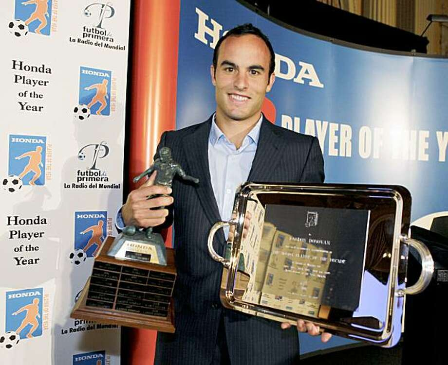 Los Angeles Galaxy soccer star Landon Donovan holds awards naming him Honda Player of the Year, left, the only six-time winner of the award, and Player of the Decade, during a news conference in Los Angeles, on Tuesday, Oct. 20, 2009.  (AP Photo/Reed Saxon) Photo: Reed Saxon, AP