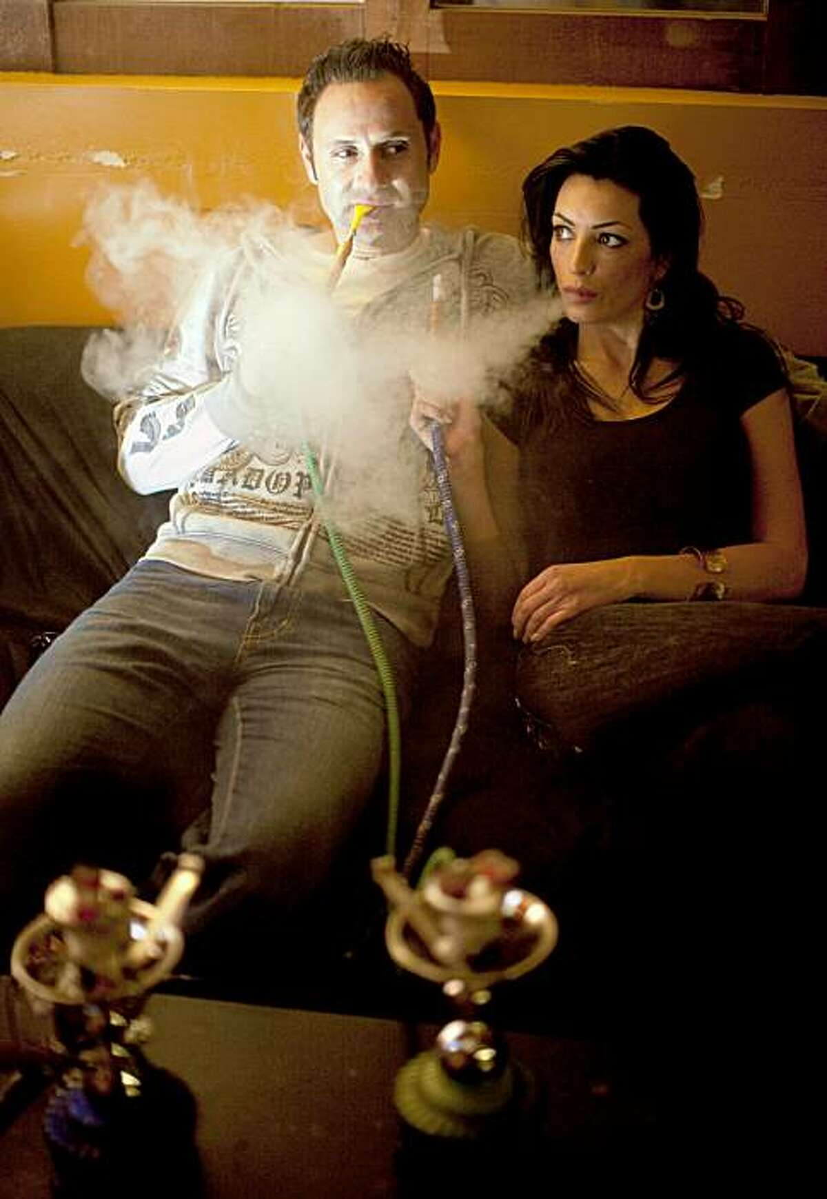 Paul Zumot and his girlfriend, Jennifer Schipsi, smoking hookah pipes at Da Hookah Spot. Zumot was arrested Oct. 19 on suspicion of murdering Schipsi.