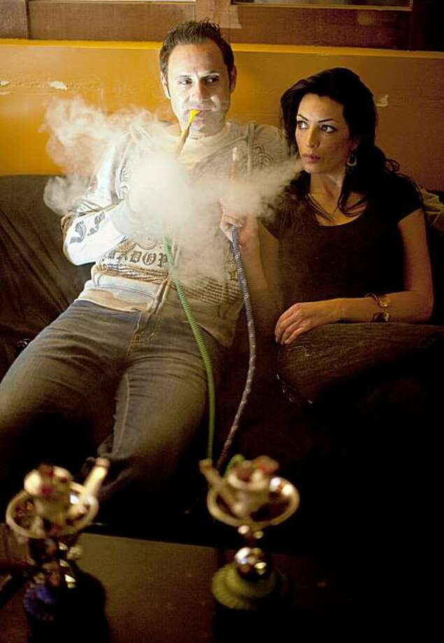 Paul Zumot and his girlfriend, Jennifer Schipsi, smoking hookah pipes at Da Hookah Spot. Zumot was arrested Oct. 19 on suspicion of murdering Schipsi. Photo: Craig Lee, Special To The Chronicle