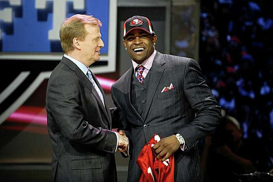NEW YORK - APRIL 25:  NFL Commissioner Roger Goodell poses with with San Francisco 49ers #10 draft pick Michael Crabtree at Radio City Music Hall for the 2009 NFL Draft on April 25, 2009 in New York City  (Photo by Jeff Zelevansky/Getty Images) Photo: Jeff Zelevansky, Getty Images
