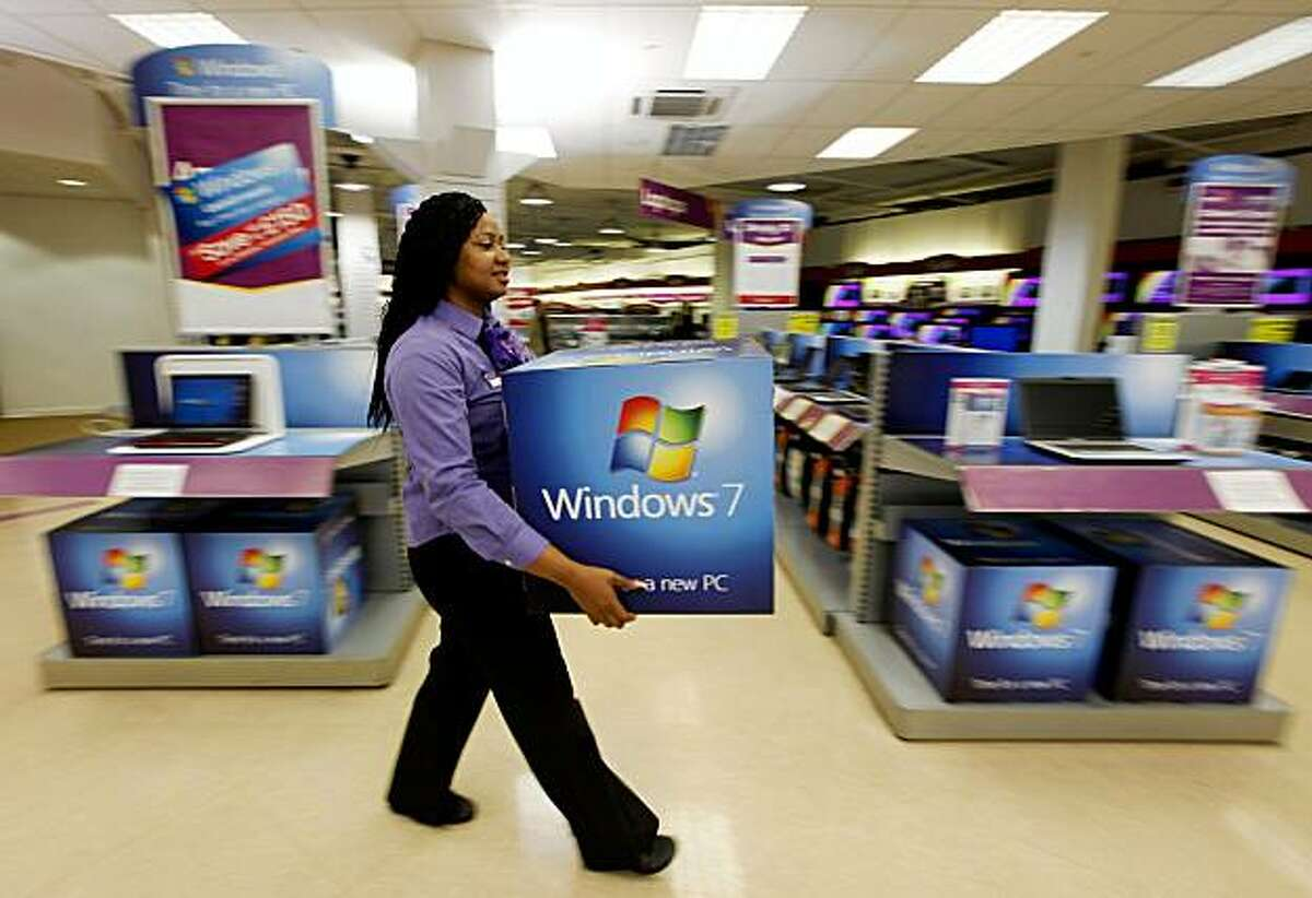 LONDON, ENGLAND - OCTOBER 21: A computer store employee carries promotional signage for Microsoft's new operating system 'Windows 7' ahead of its official launch at midnight tonight on October 21, 2009 in London, England. Microsoft's much-anticipated version of its Windows operating system for PCs aims to eradicate many of the problems associated with its predecessor 'Vista'. (Photo by Oli Scarff/Getty Images)