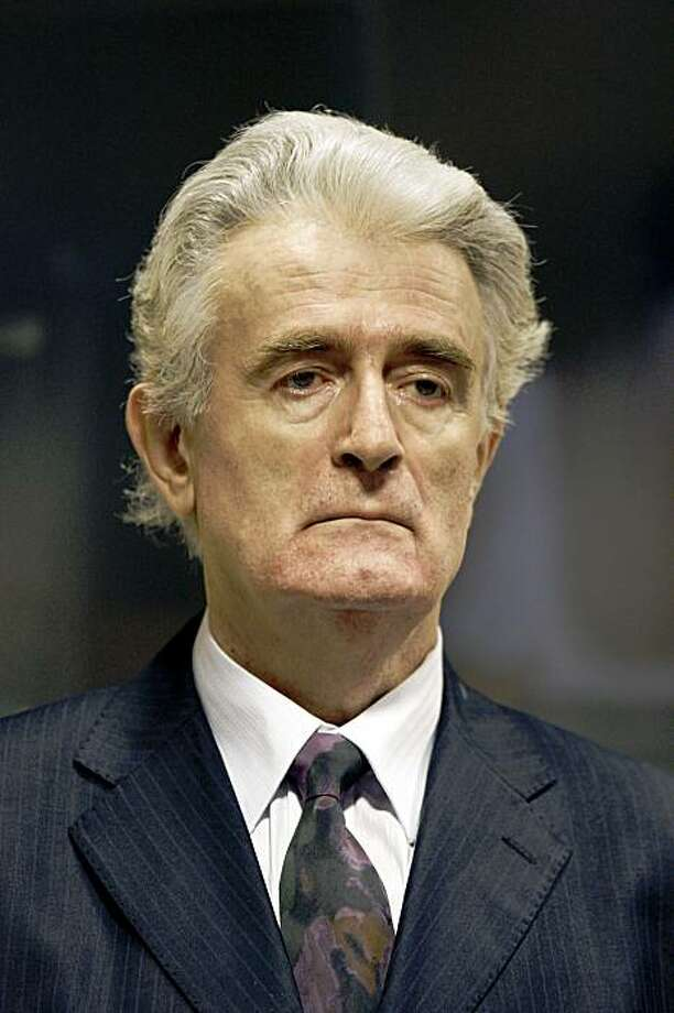(FILES) In this file picture taken on July 31, 2008 Former Bosnian Serb leader Radovan Karadzic is pictured in the court room of the International Criminal Tribunal for the Former Yugoslavia at the start of his initial appearance in The Hague. Bosnian Serb wartime leader Radovan Karadzic has told a UN court that he intends to boycott the start of his war crimes and genocide trial next week, his lawyer said on October 22, 2009.  AFP PHOTO/POOL/JERRY LAMPEN (Photo credit should read JERRY LAMPEN/AFP/Getty Images) Photo: Jerry Lampen, AFP/Getty Images