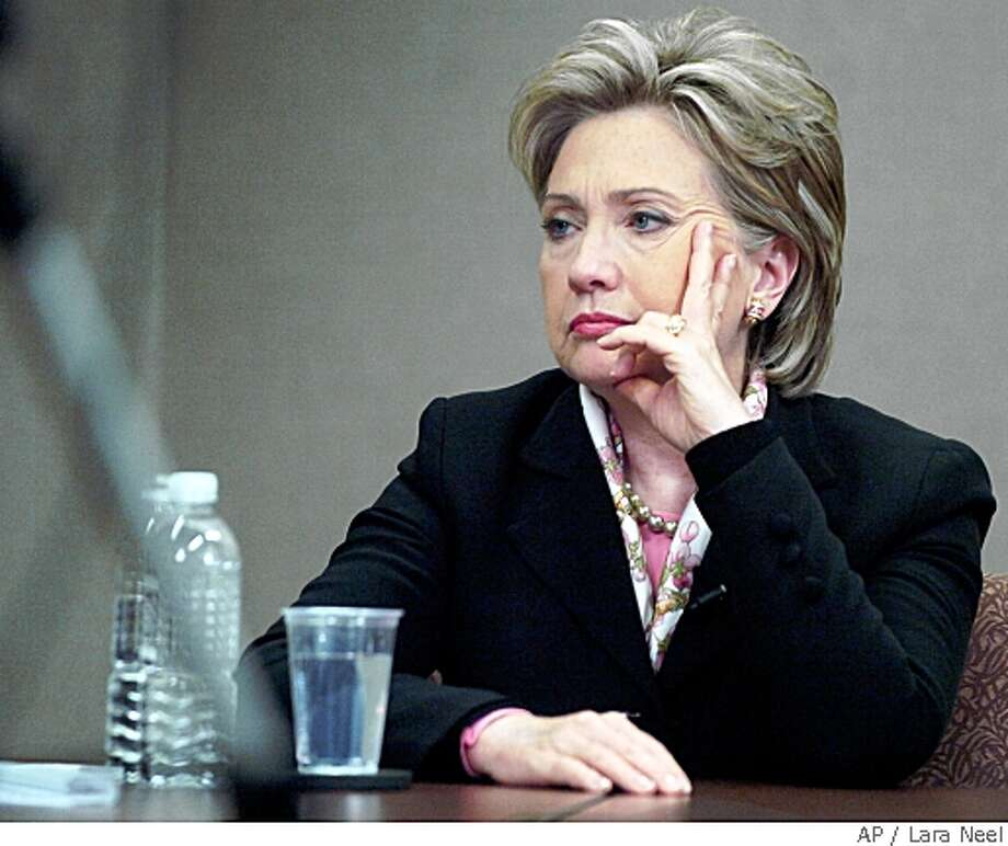 Democratic presidential hopeful, Sen. Hillary Rodham Clinton, D-N.Y., listens to a question while speaking with the Argus Leader Editorial Board, Friday, May, 23, 2008 in Sioux Falls, S.D. Sen. Hillary Rodham Clinton quickly apologized Friday after citing the June 1968 assassination of Robert F. Kennedy in defending her decision to keep running for the Democratic presidential nomination despite increasingly long odds. (AP Photo/The Argus Leader, Lara Neel) Photo: Lara Neel, AP