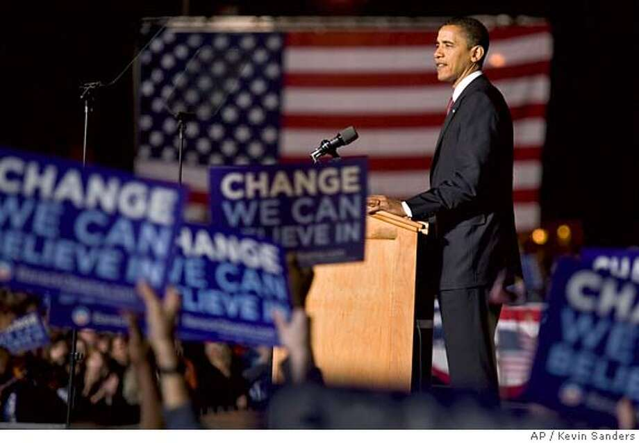 "Democratic presidential hopeful Sen. Barack Obama, D-Ill., speaks at a rally in downtown Des Moines, Iowa, on Tuesday, May 20, 2008. Obama declared himself ""within reach"" of the Democratic nomination and celebrated in the state where his win in the opening contest of the presidential primary season helped reshape the race. (AP Photo/Kevin Sanders) Photo: Kevin Sanders"