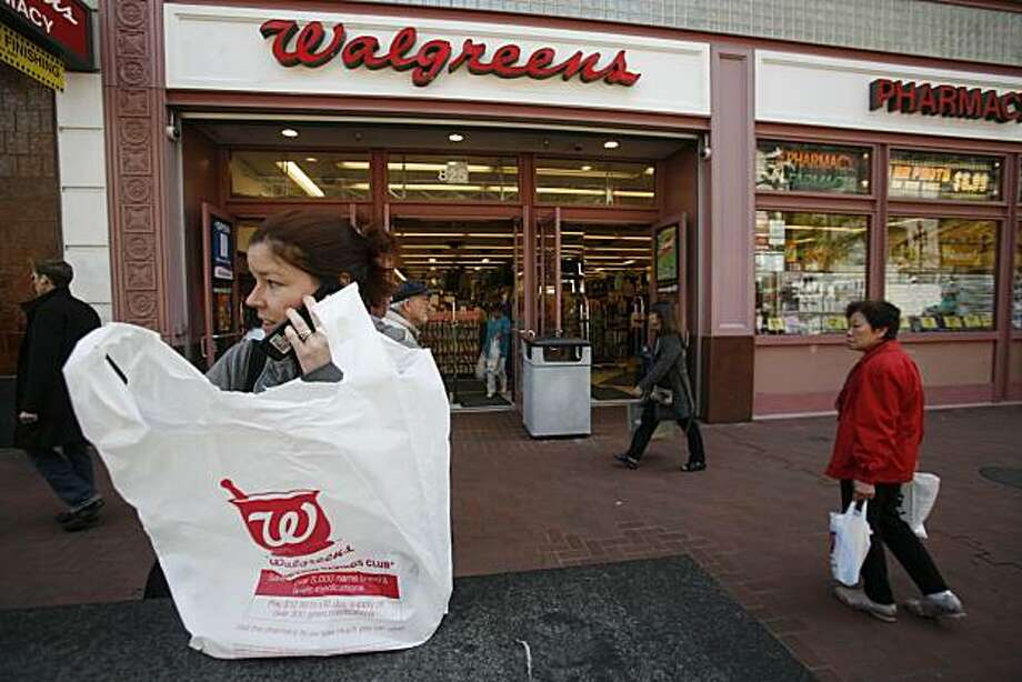 Anna Sager of San Francisco, Calif. holds newly purchased goods in a new degradable (not necessarily biodegradable) Walgreens bag in front of the 850 Market Street store on Monday May 19, 2008 in San Francisco, Calif. The store is in the process of phasing out non-degradable plastic bags in preparation for the city-wide ban on them starting May 20, 2008. Photo by Mike Kepka / San Francisco Chronicle Photo: Mike Kepka, SFC