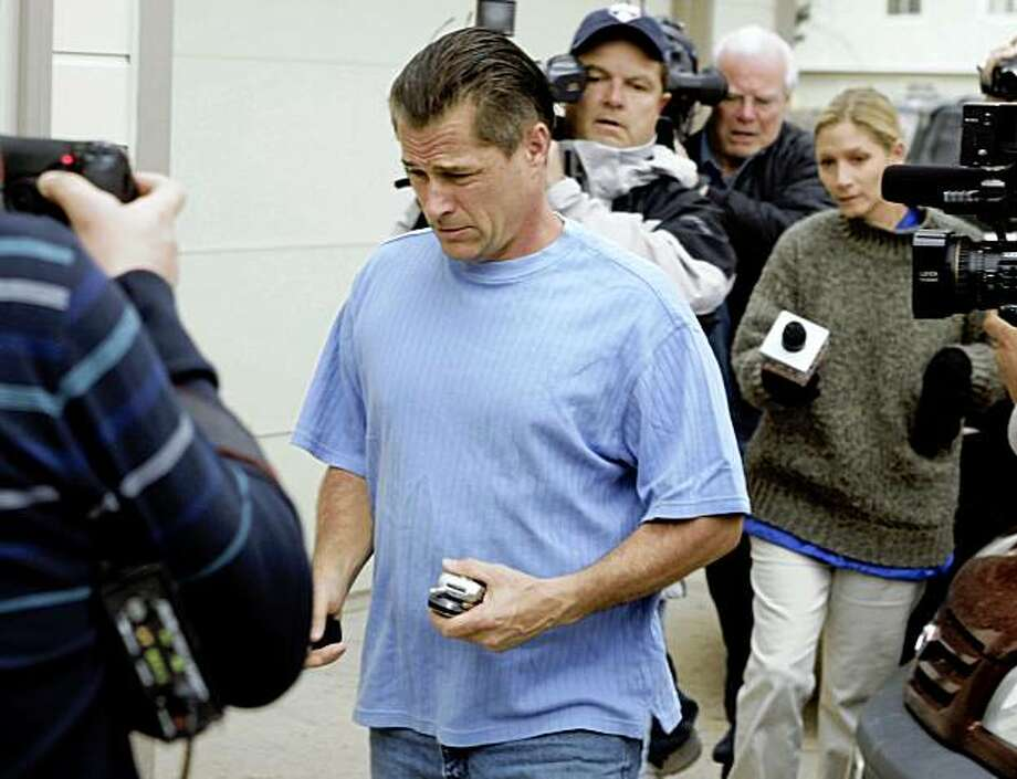 Richard Heene walks back to his home Monday, Oct. 19, 2009 in Fort Collins, Colo. The lawyer for Heene, who is accused of perpetrating the balloon boy hoax to promote a reality show, said Monday that he expects authorities to bring charges against his client in the next day as investigators analyze e-mails that show Richard Heene and an associate discussing the stunt months ago. (AP Photo/Will Powers) Photo: Will Powers, AP