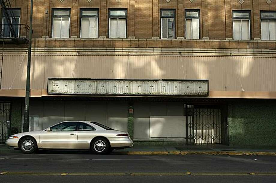 A new car is parked in front of an abandoned building in a deserted section of the downtown area  in April 2008 in Stockton. Photo: Justin Sullivan, Getty Images