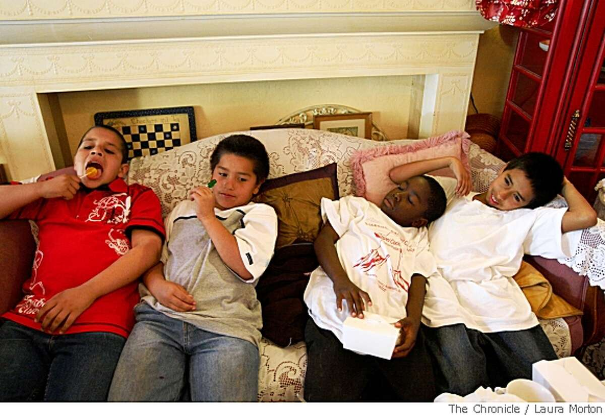 Flynn Elementary School students 10-year-old, Alejandro Valle, 9-year-old Luis Flores, 9-year-old Raymon Brown and 10-year-old Rodolfo Trejo (left to right) relax at Lovejoys Tea Room in San Francisco, Calif., on Friday, May 23, 2008. The students have been meeting once a week all year for a traditional book club and were celebrating their year with a field trip to the tea room. (Laura Morton / Special to The Chronicle)
