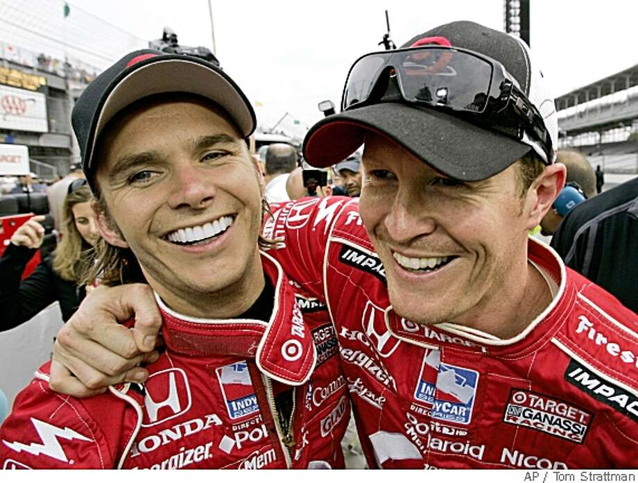 ** FILE ** In this May 10, 2008 file photo, pole-sitter Scott Dixon, of New Zealand, right, celebrates with teammate Dan Wheldon, of England, on the first day of qualifications for the Indianapolis 500 auto race at the Indianapolis Motor Speedway in Indianapolis. Dixon is quiet, soft-spoken and would rather avoid the spotlight. Wheldon embraces stardom with his warm, outgoing personality. But as teammates, the drivers holding the first two starting spots in this year's Indianapolis 500 have formed a real bond.   (AP Photo/Tom Strattman) Photo: Tom Strattman, AP