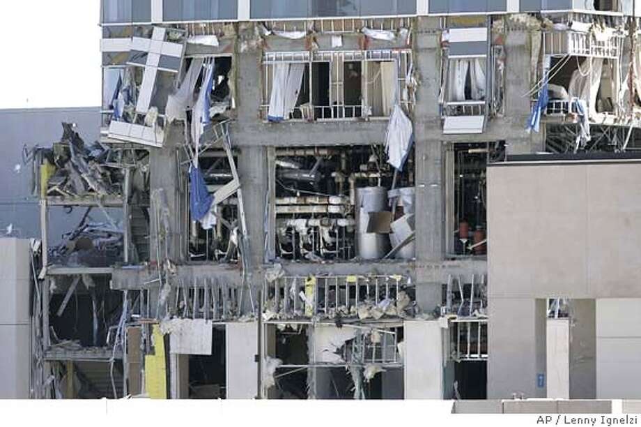 ###Live Caption:A heavily damaged three story section of a Hilton hotel under construction on the harbor in San Diego is shown Monday May 19, 2008 after an explosion took place in the sixth floor area. (AP Photo/Lenny Ignelzi).###Caption History:A heavily damaged three story section of a Hilton hotel under construction on the harbor in San Diego is shown Monday May 19, 2008 after an explosion took place in the sixth floor area. (AP Photo/Lenny Ignelzi).###Notes:###Special Instructions: Photo: Lenny Ignelzi