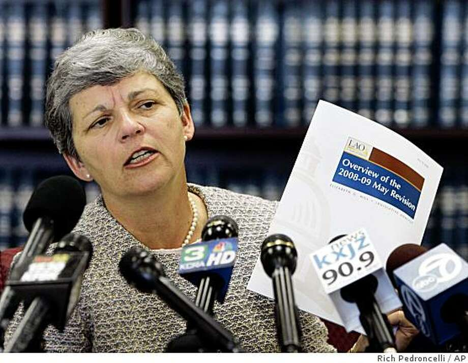 Legislative Analyst Elizabeth Hill displays a copy of her office's analysis of Gov. Arnold Schwarzengger's revised 2008-2009 state budget during a news conference in Sacramento, Calif., Monday, May 19, 2008.  Hill said that Schwarzenegger's plan to use the lottery to help balance his proposed $144.3 billion state budget relies on rosy revenue projections that ultimately could complicate efforts to fund education.  (AP Photo/Rich Pedroncelli) Photo: Rich Pedroncelli, AP