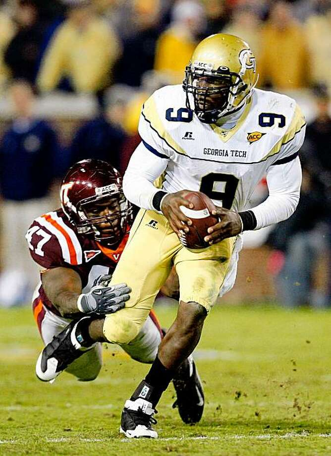 ATLANTA - OCTOBER 17:  Quarterback Josh Nesbitt #9 of the Georgia Tech Yellow Jackets rushes upfield away from Nekos Brown #47 of the Virginia Tech Hokies at Bobby Dodd Stadium on October 17, 2009 in Atlanta, Georgia.  (Photo by Kevin C. Cox/Getty Images) Photo: Kevin C. Cox, Getty Images