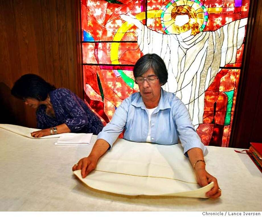 "###Live Caption:Linda Morgan and Ida Valenzuela prepare the chapel alter for another service after Daily Mass was performed Wednesday May 14, 2008. The Arch Diocese of Oakland has decided to close St. Alphonsus Liguori, a Catholic parish in San Leandro. The congregation couldn't support itself financially, particularly as retrofitting and other building repair costs escalated. But the diocese has said the church also lacked spiritual ""vibrancy,"" as defined by several criteria. The church has essentially become like a senior center, where mostly elderly come. Photographed in San Leandro, Calif, By Lance Iversen / San Francisco Chronicle.###Caption History:Linda Morgan and Ida Valenzuela prepare the chapel alter for another service after daily mass was performed Wednesday May 14, 2008. The Diocese of Oakland has decided to close St. Alphonsus Liguori, a Catholic parish in San Leandro. The congregation couldn't support itself financially, particularly as retrofitting and other building repair costs escalated. But the diocese has said the church also lacked spiritual vibrancy, as defined by several criteria. The mostly elderly congregation came because it provided them with intimacy. But the small size was also part of the reason it was closed. Photographed in San Leandro, Calif, By Lance Iversen / San Francisco Chronicle.###Notes:Lance Iversen 415-2979395  CQ###Special Instructions:MANDATORY CREDIT PHOTOG AND SAN FRANCISCO CHRONICLE. Photo: LANCE IVERSEN"