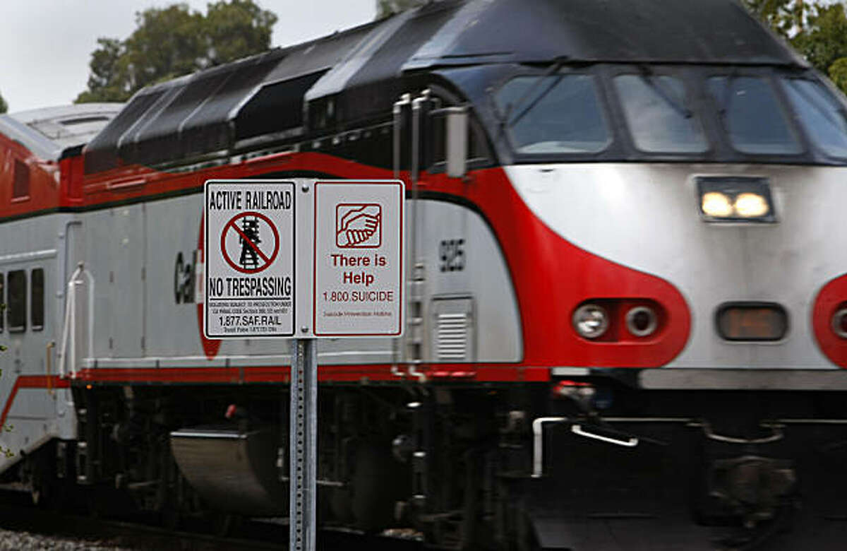 In this file photo, a sign warns pedestrians near the crossing of the CalTrain tracks in Palo Alto. A 16 year old boy was struck and killed early Tuesday by a Caltrain commuter train.