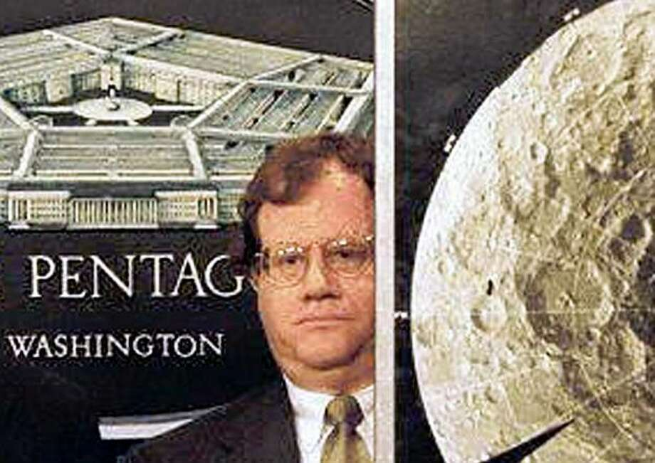 "(FILES): This December 3, 1996 file photo shows Dr. Stewart Nozette during a press briefing at the Pentagon in Washington, DC standing beside a photograph of the Moon's south pole taken by the US space probe Clementine.  Nozette, a leading American scientist who had worked for the White House and NASA, was arrested and charged with attempted spying for Israel on October 19, 2009  in the Washington suburb of Chevy Chase, Maryland.   Nozette, 52, was apprehended  after a sting operation involving an undercover FBI agent, the Department of Justice said, adding that there was no wrongdoing by Israel.  He is charged with ""attempted espionage for knowingly and willfully attempting to communicate, deliver, and transmit classified information relating to the national defense of the United States to an individual that Nozette believed to be an Israeli intelligence officer.""       AFP PHOTO / Files (Photo credit should read -/AFP/Getty Images) Photo: -, AFP/Getty Images"