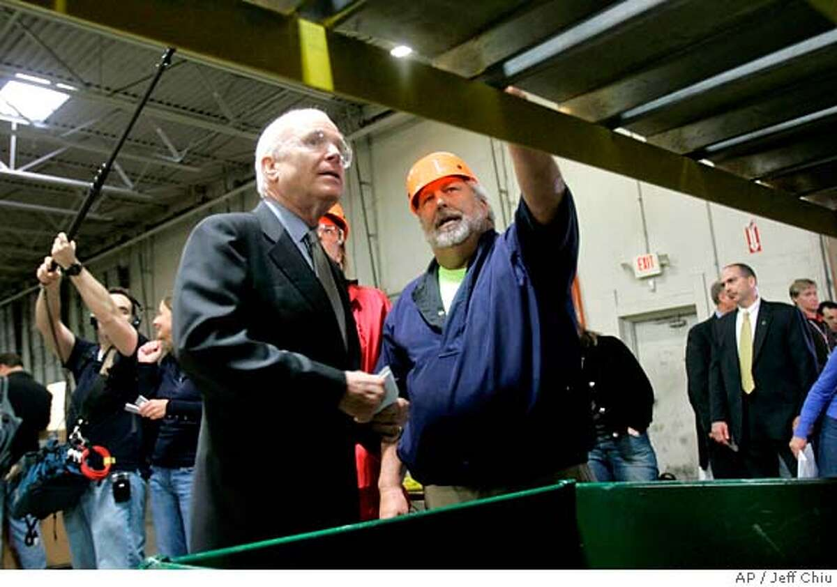 Republican presidential candidate, Sen. John McCain, R-Ariz., left, tours the Ohio eWaste Recycling plant with Guy Wolfenbarger Wednesday, May 14, 2008, in Obetz, Ohio. (AP Photo/Jeff Chiu)