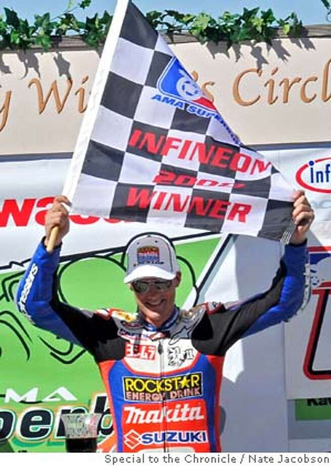 Kawasaki AMA Superbike Showdown winner Ben Spies celebrates at Infineon Raceway on Saturday, May 17, 2008. Photo by Nate Jacobson / Special to the Chronicle  Ran on: 05-18-2008  Ben Spies won the Superbike Showdown, ahead of teammate Mat Mladin. Photo: Nate Jacobson