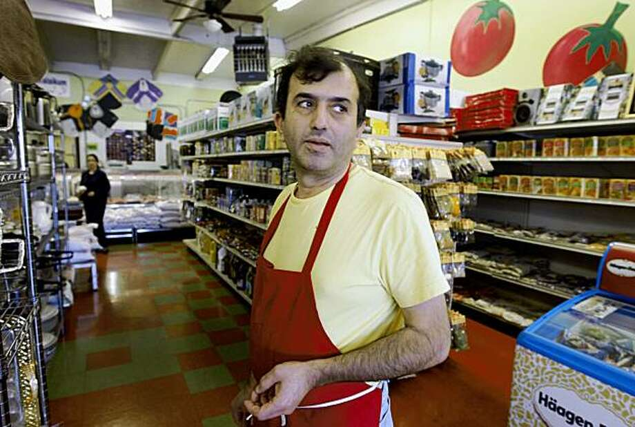 "Sam Saleh, owner of the Little Kabul Market in Fremont, Calif., reacts to recent political developments in Afghanistan on Tuesday, Oct. 20, 2009. Saleh says his uncle, who lives in Afghanistan, says it's not safe. ""They're scared,"" said Saleh. Photo: Paul Chinn, The Chronicle"