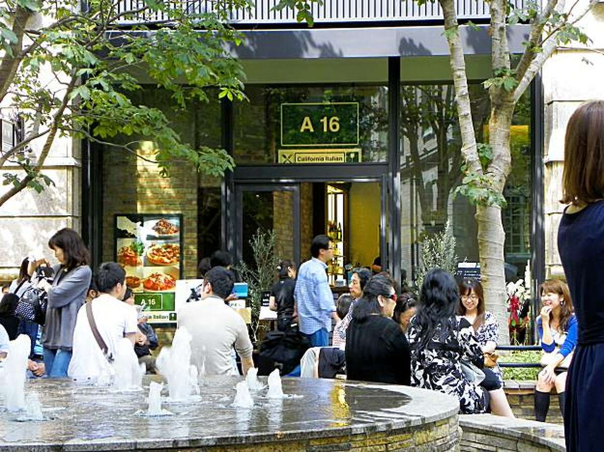 A16 opened a Tokyo outpost last month. Diners wait outside for an open table.