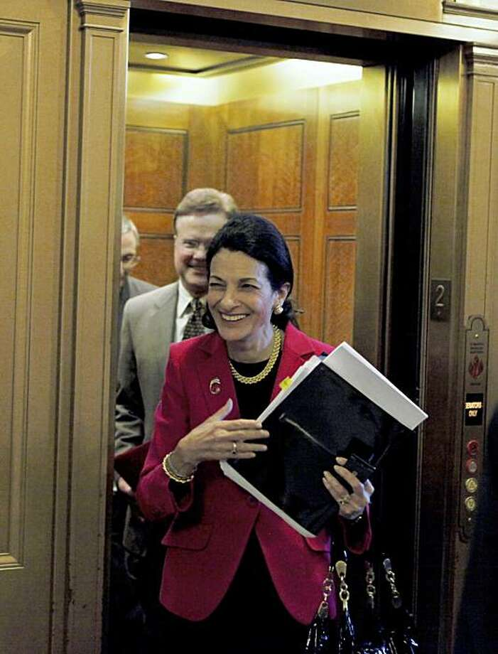 Sen. Olympia Snowe, R-Maine, followed by Sen. Jim Webb, D-Va., steps out of an elevator as she makes her way to the Senate floor on Capitol Hill in Washington, Wednesday, Oct. 14, 2009, for a vote, one day after siding with Democrats on a crucial Senate Finance Committee vote on the health care reform bill. (AP Photo/Charles Dharapak) Photo: Charles Dharapak, AP