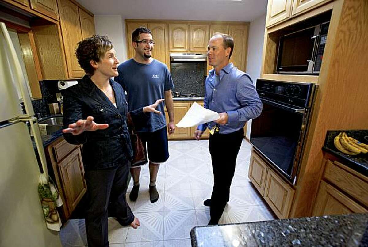 Kevin Kieffer, (right) a realtor with Keller Williams Real Estate, shows first time buyers Megan and Jeremy Brotherton a home in Livermore, Ca. which is a short sale property, on Tuesday October 13, 2009.