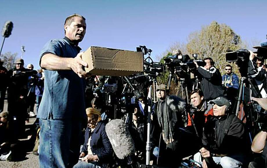 Richard Heene, who, with his wife Mayumi, frantically told an emergency dispatcher their 6-year-old son had floated off in an inflatable balloon, holds a box for written questions during a news conference Saturday, Oct. 17, 2009 in Fort Collins, Colo. Photo: Will Powers, AP