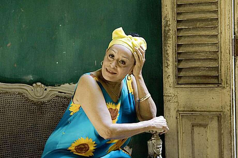 Omara Portuondo, the sultry-voiced diva of the Buena Vista Social Club, has been granted permission to visit the US for the first time since 2003. (AP) Photo: Unknown