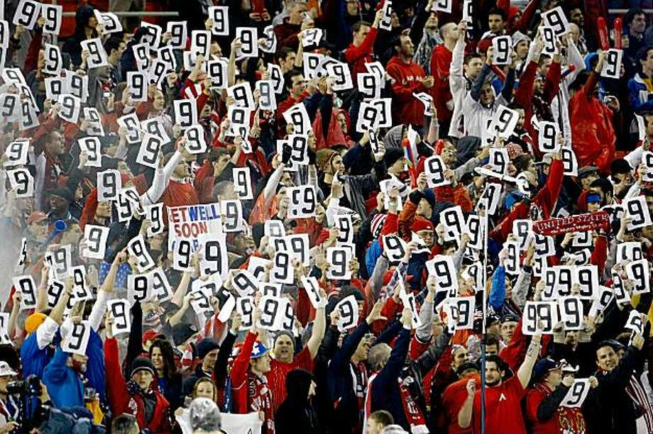 WASHINGTON - OCTOBER 14:  U.S. fans hold up signs for Charlie Davies who was injured in a car accident yesterday during the first half of a match against Costa Rica in the FIFA 2010 World Cup Qualifier at RFK stadium on October 14, 2009 in Washington, DC.  (Photo by Win McNamee/Getty Images) Photo: Win McNamee, Getty Images