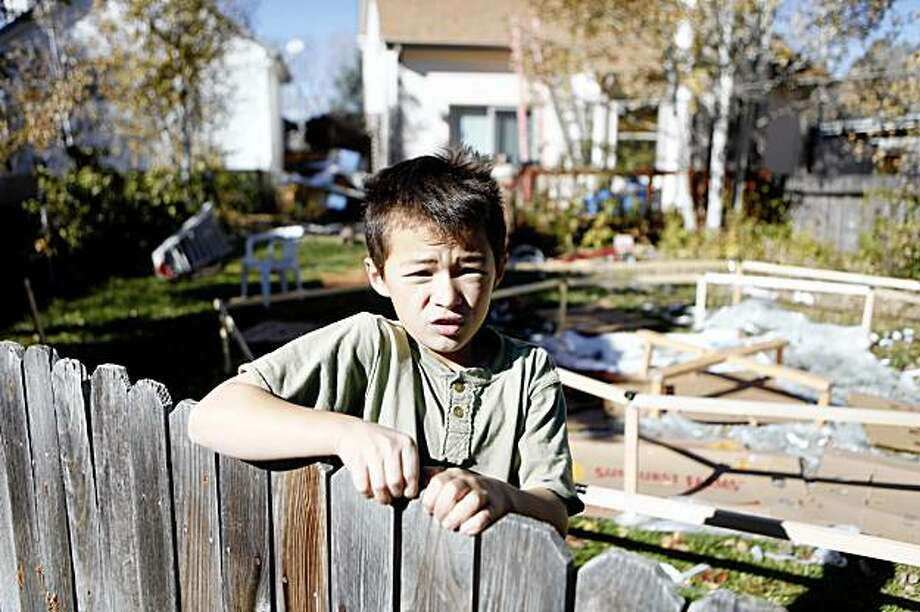 Ryo Heene, the 9-year-old brother of Falcon Heene, plays in the backyard of his parents home in Fort Collins, Colo., on Friday, Oct. 16, 2009. His younger brother, 6, was thought to be in a helium balloon that took off from the wooden platform at right. It set off a national uproar as authorities scoured the plains of northern Colorado for the youngster. Turns out, he was hiding in the rafters of the family's garage. (AP Photo/Ed Andrieski) Photo: Ed Andrieski, AP