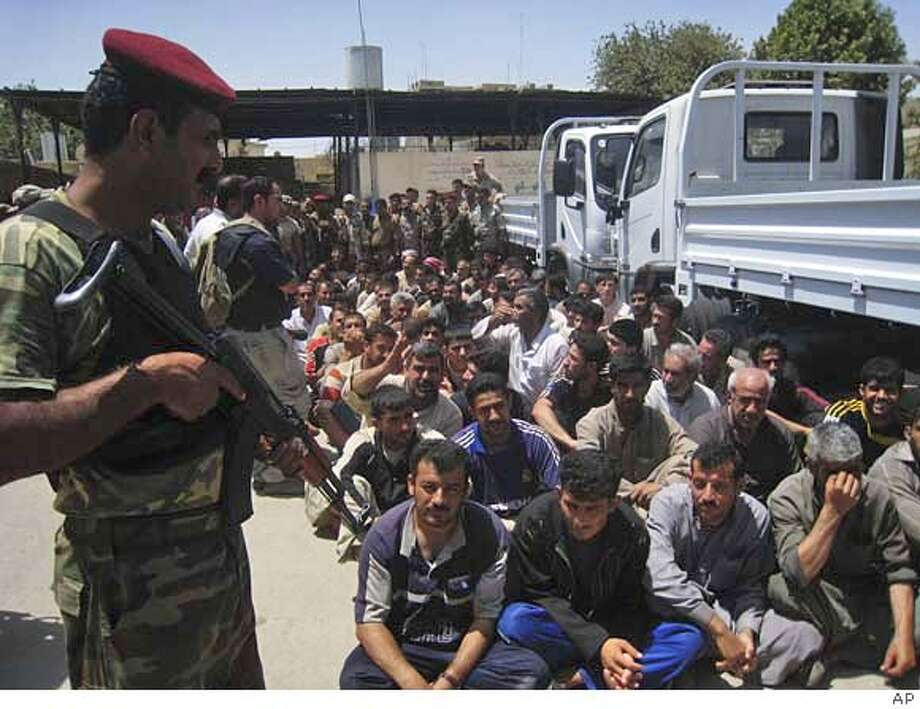 ###Live Caption:Detainees sit at an Iraqi army base in Mosul, Iraq, Monday, May 19, 2008. Some 1300 people were detained since the start of the Iraqi army operations in Mosul last week. Mosul, 360 kilometers (225 miles) northwest of Baghdad, has been the most prominent al-Qaida urban stronghold in Iraq. (AP Photo)###Caption History:Detainees sit at an Iraqi army base in Mosul, Iraq, Monday, May 19, 2008. Some 1300 people were detained since the start of the Iraqi army operations in Mosul last week. Mosul, 360 kilometers (225 miles) northwest of Baghdad, has been the most prominent al-Qaida urban stronghold in Iraq. (AP Photo)###Notes:###Special Instructions: Photo: STR