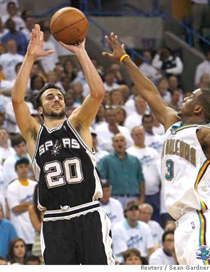 ###Live Caption:San Antonio Spurs guard Manu Ginobili (L) shoots past New Orleans Hornets guard Chris Paul (R) during the fourth quarter in Game 7 of their second round NBA playoff basketball series in New Orleans, Louisiana, May 19, 2008. REUTERS/Sean Gardner (UNITED STATES)###Caption History:San Antonio Spurs guard Manu Ginobili (L) shoots past New Orleans Hornets guard Chris Paul (R) during the fourth quarter in Game 7 of their second round NBA playoff basketball series in New Orleans, Louisiana, May 19, 2008. REUTERS/Sean Gardner (UNITED STATES)###Notes:Spurs' Ginobili shoots past Hornets' Paul during the fourth quarter in Game 7 of their second round NBA playoff basketball series in New Orleans###Special Instructions: Photo: SEAN GARDNER