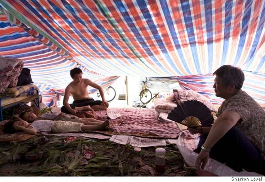 ###Live Caption:Homeless residents live in the central park in Jiangyo,###Caption History:Homeless residents live in the central park in Jiangyo,###Notes:###Special Instructions: Photo: Sharron Lovell