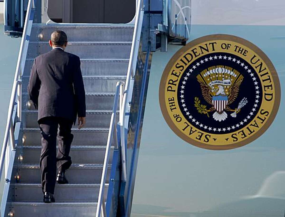 President Obama boards Air Force One before departing from SFO in San Francisco, Calif., on Friday, Oct. 16, 2009 after attending a Democratic fundraiser Thursday evening.