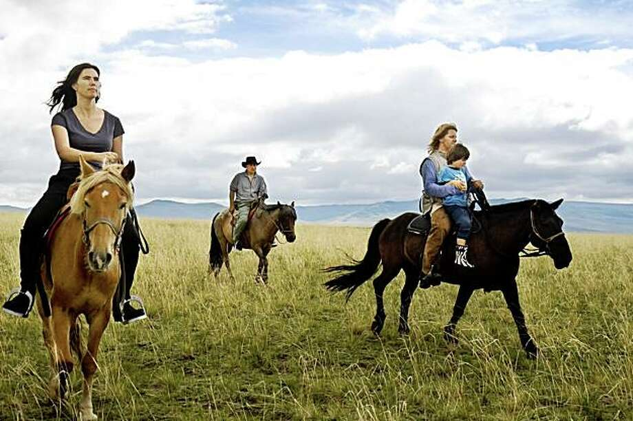 Movie still from THE HORSE BOY:  Members of the Isaacson family ride horses in Mongolia.   Horseboy Rowan. Photo: Outnow.com Justin Jin