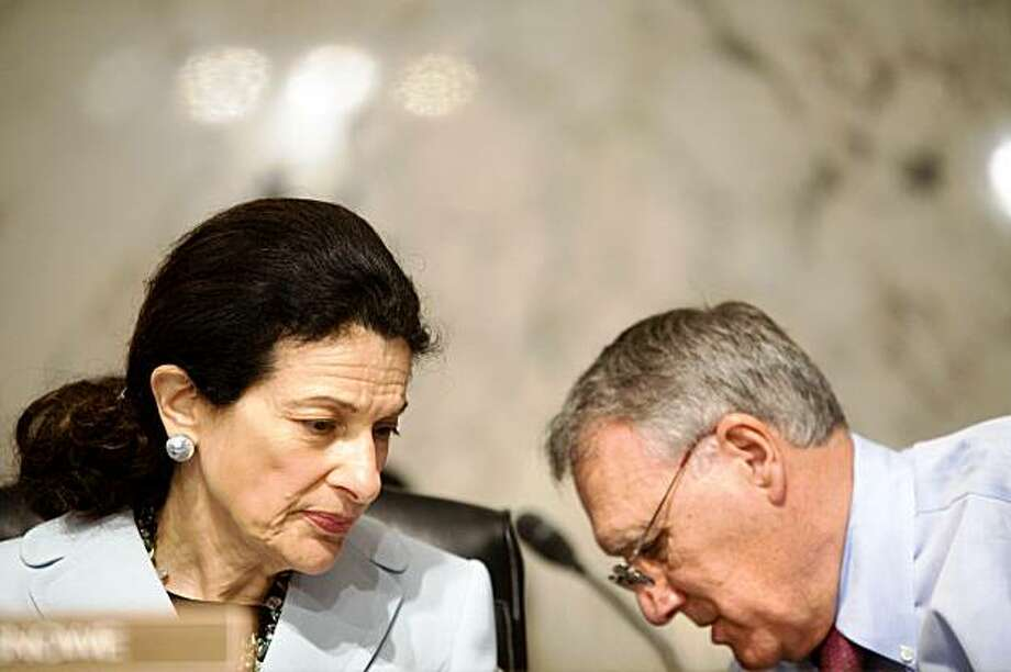 Republican Sens. Olympia Snowe of Maine and Jon Kyl of Arizona during Tuesday's session of the Senate Finance Committee on Capitol Hill in Washington, Oct. 13, 2009. With the Senate Finance Committee meeting on Tuesday to vote on the big health care legislation, all the attention was focused on Sen. Snowe who is the only Republican on the panel who has expressed willingness to support the bill. (Stephen Crowley/The New York Times) Photo: Stephen Crowley, NYT