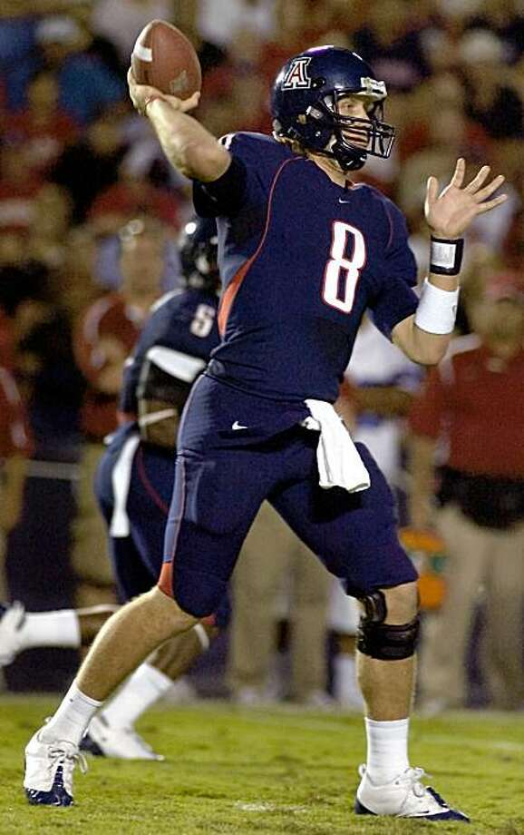 Arizona's starting quarterback Nick Foles (8) passes out of the backfield against Stanford during the second half of a NCAA college football game at Arizona Stadium in Tucson, Ariz., Saturday, Oct. 17, 2008. Arizona won 43-38. (AP Photo/John Miller) Photo: John Miller, AP