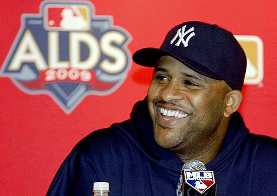 New York Yankees pitcher CC Sabathia smiles as he discusses the team's upcoming American League division series baseball game during a press conference at Yankee Stadium Tuesday, Oct. 6, 2009 in New York. Sabathia is scheduled to start Game 1. (AP Photo/Kathy Willens) Photo: Kathy Willens, AP