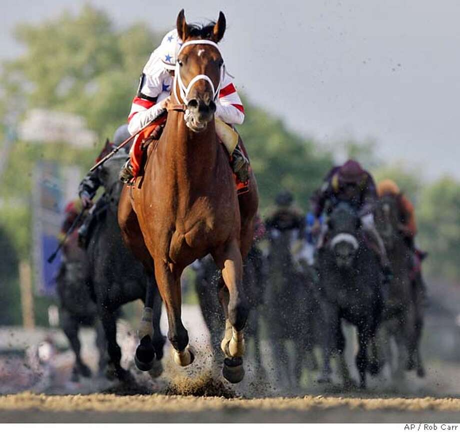 Big Brown ridden by Kent Desormeaux crosses the finish line to win the 133rd Preakness horse race at Pimlico Race Course, Saturday, May 17, 2008, in Baltimore. (AP Photo/Rob Carr) Photo: Rob Carr