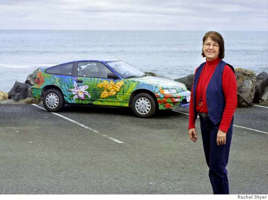 When Hallie Gardo decided to follow a popular Key West practice of a wild paint job on her car, she recruited a local artist. She says, �I had asked for a tropical rain forest with the sun, moon, stars and a rainbow on the roof, and there it gloriously was before my eyes � It looked to me like the perfect car for the art teacher!� Photo: Rachel Styer