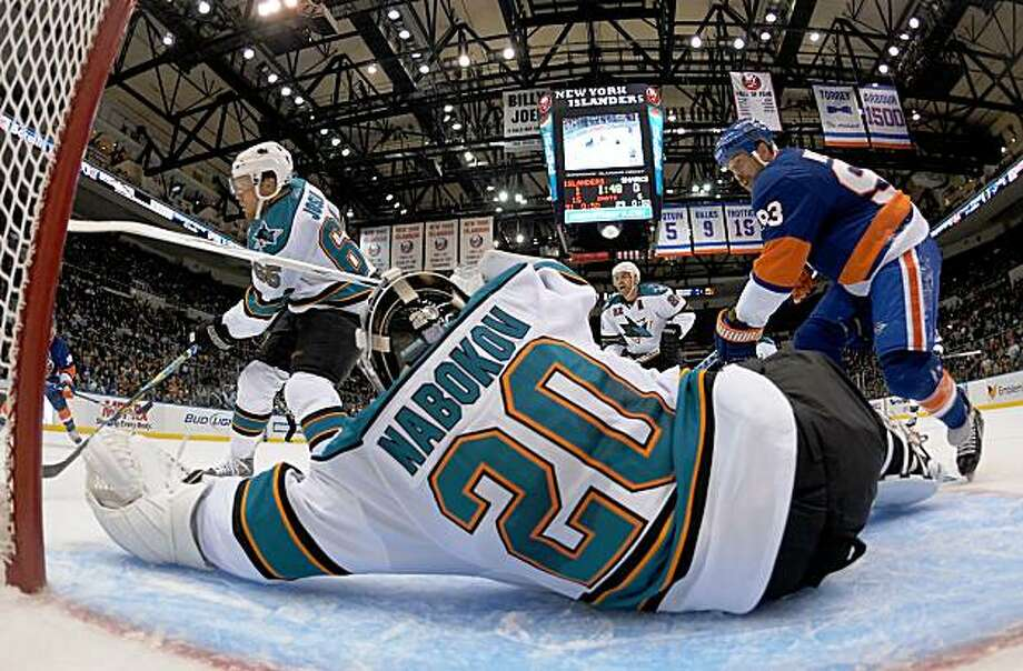 UNIONDALE, NY - OCTOBER 17: Doug Weight #93 of the New York Islanders is stopped by Evgeni Nabokov #20 of the San Jose Sharks at the Nassau Coliseum on October 17, 2009 in Uniondale, New York. (Photo by Bruce Bennett/Getty Images) Photo: Bruce Bennett, Getty Images