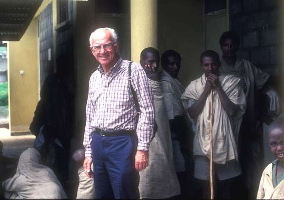 ###Live Caption:Obit photo of Theodore M. Myers. Taken at Tedda Clinic, Tedda, Ethiopia. 1986. Tedda Clinic was established by Ted for non-sectarian local healthcare. Myers was a local physician who contributed selflessly to the poor of Somalia and Ethiopia.###Caption History:Obit photo of Theodore M. Myers. Taken at Tedda Clinic, Tedda, Ethiopia. 1986. Tedda Clinic was established by Ted for non-sectarian local healthcare. Myers was a local physician who contributed selflessly to the poor of Somalia and Ethiopia.###Notes:###Special Instructions: Photo: Photo By Peggy Myers