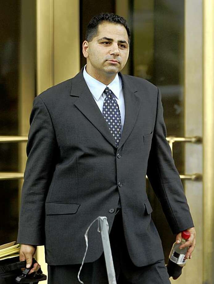 FILE - In this Monday, June 12, 2006  file photo, David Safavian, the former chief of staff at the General Services Administration, leaves the  U.S. District Courthouse,  in Washington.  Stung by a jury that deadlocked on charges against a former lobbyist, federal prosecutors in the Jack Abramoff influence-peddling scandal are returning to court in an attempt to make sure one of their biggest catches is sent to prison. (AP Photo/Manuel Balce Ceneta, file) Photo: Manuel Balce Ceneta, File, AP