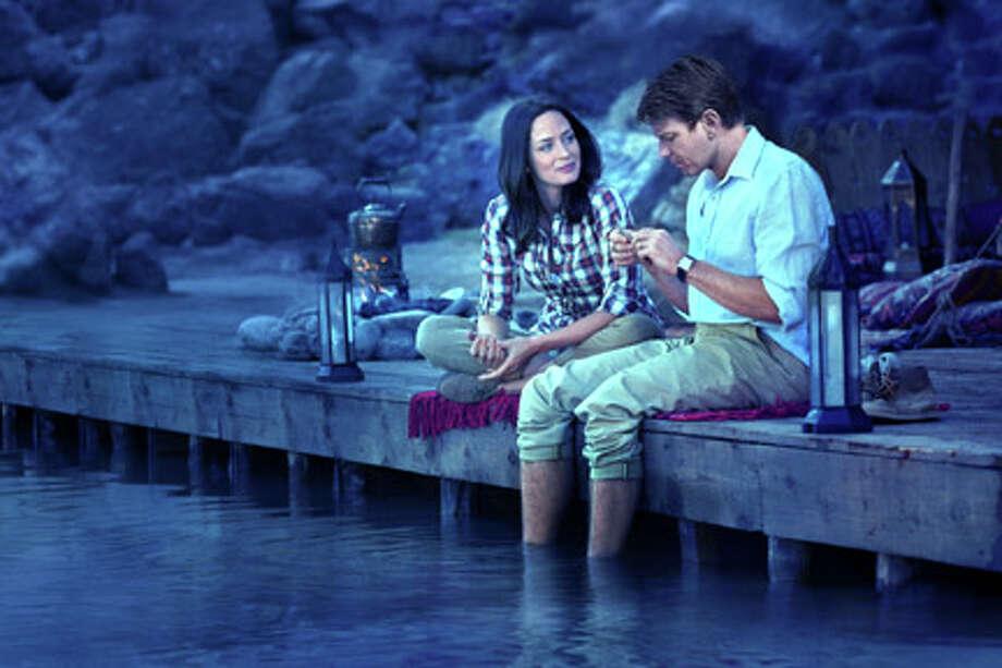 "Emily Blunt as Harriet Chetwode-Talbot and Ewan McGregor as Fred Jones in ""Salmon Fishing in the Yemen."""