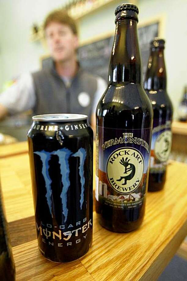 "Matt Nadeau displays a can of Monster energy drink and a bottle of Vermonster beer at Rock Art Brewery in Morrisville, Vt., Monday, Oct. 12, 2009.  The Vermont brewery that sells a beer called ""Vermonster"" has been told by Hansen Beverage Co., the maker of Monster energy drinks, to stop selling the brew. (AP Photo/Toby Talbot) Photo: Toby Talbot, AP"