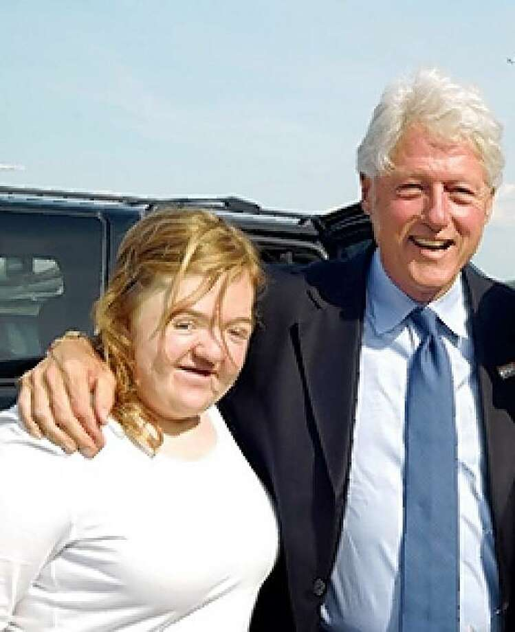 Lili Rachel Smith, the daughter of San Francisco political campaign consultant Ace Smith, with former President Bill Clinton (crop out the woman on the right) Photo: Smith Family