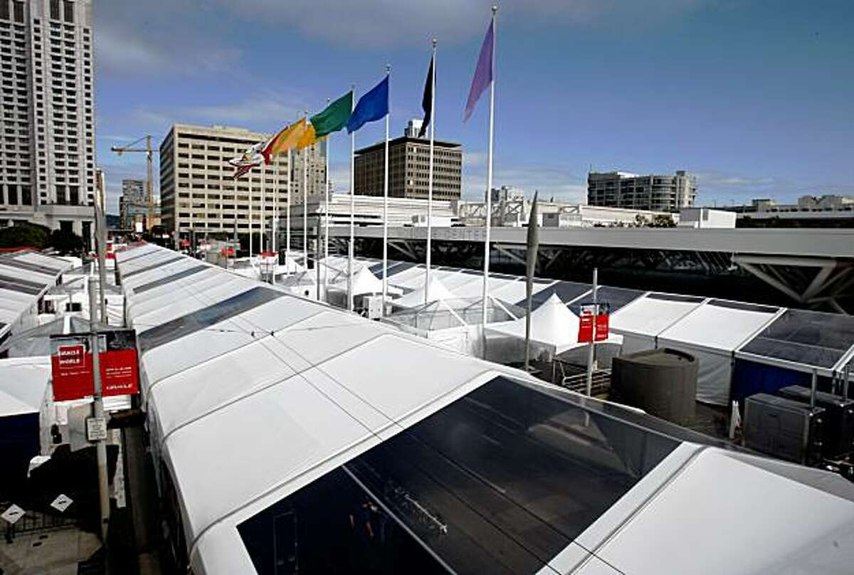 Tents are erected on a one-block stretch of Howard Street in front of the Moscone Convention Center for the week-long Oracle OpenWorld conference in San Francisco, Calif., on Friday, Sept. 19, 2008.